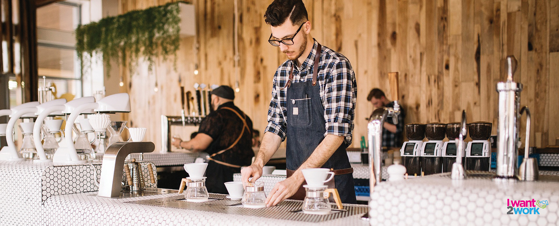 why you should work in hospitality barista making a coffee