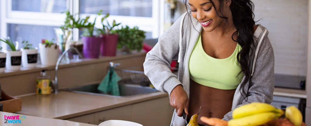 fit lady female girl in kitchen cutting pear cooking healthy breakfast fuel for busy work day
